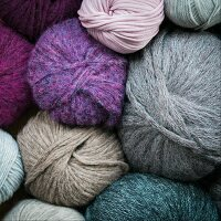 Balls of wool in various colours and materials