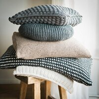 A stack of homemade cushions