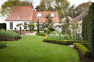 House in well-tended gardens with clipped lawn