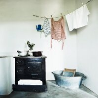 Antique cooker, washing line, zinc tub and washboard in utility room