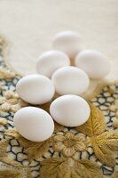 White eggs on floral embroidered vintage tablecloth