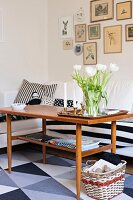 Retro coffee table in living room decorated with graphic patterns