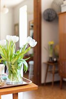 Vase of white tulips against blurred background