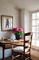 Rustic desk and armchair next to lattice window