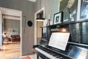 Music book on piano in grey-painted music room