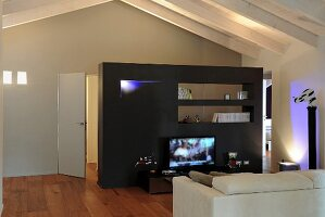 Black partition wall in attic living room