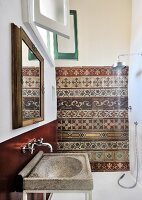 Traditional wall tiles in restored bathroom with Mediterranean ambiance