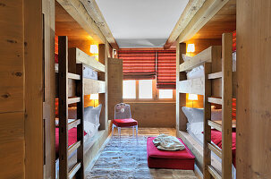 Two sets of wooden fitted bunk beds opposite on another
