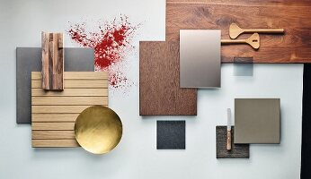 A selection of concrete, wood, brass and glass kitchen cabinet panels