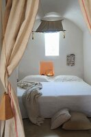 Bed in niche below awning in trullo