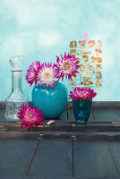 Dahlias in blue vase and blue glass