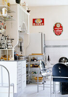 Dining area and eclectic mix of 80s and vintage furniture in kitchen