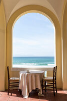 Table and two chairs in loggia with picturesque panoramic sea view