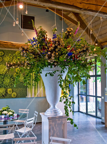 Belgian florist creates floral and wood sculpture