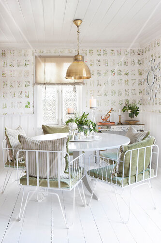 Dining room in Norway decorated with botanical prints