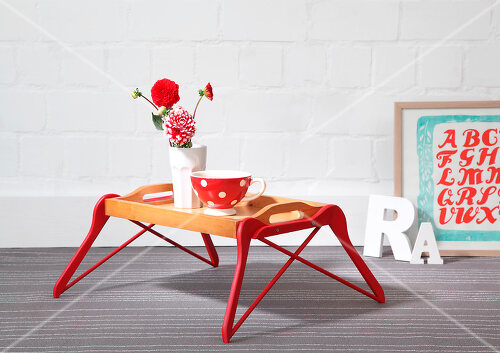 DIY table made from a tray and coat hangers