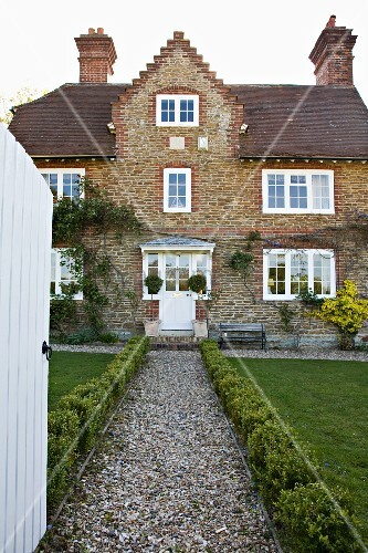 Gravel front path edged in box leading to old english country house with brick facade and white - English style window boxes living facades ...