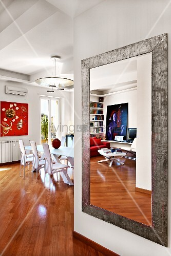contemporary full length mirror on wall of living room