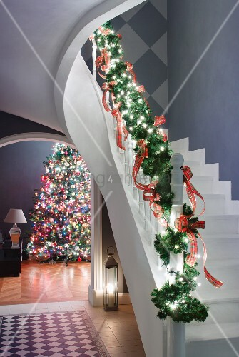 Staircase balustrade decorated with fir branches and view