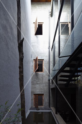 Tall Narrow Light Well With Open Shutters On Windows