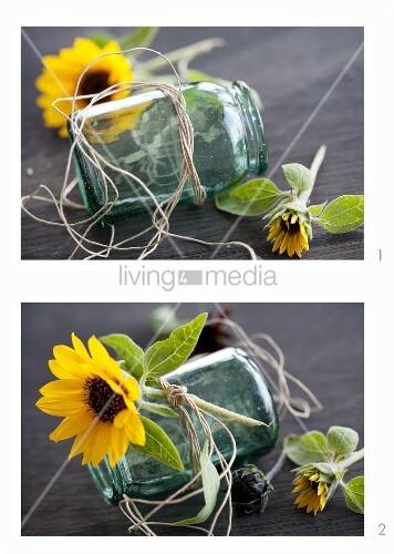Einmachglas mit Sonnenblumenblüte dekorieren