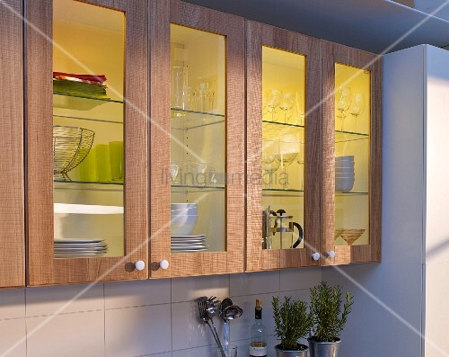 Kitchen cabinet doors refurbished with wood and glasss panels with illuminated interiors