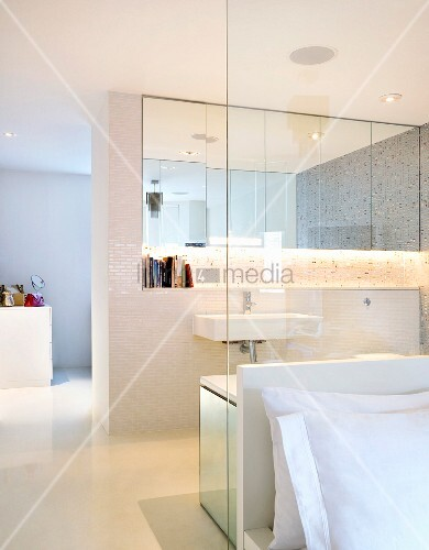 Open Bathroom Ensuite With A Glass Dividing Wall To The