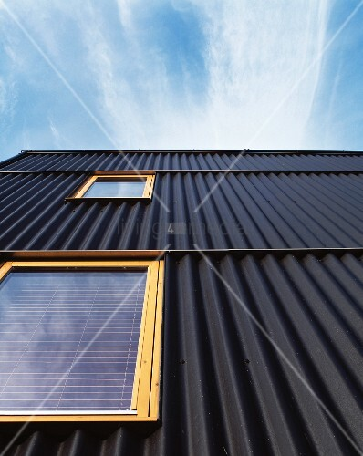 House Facade With Black Corrugated Metal Cladding And
