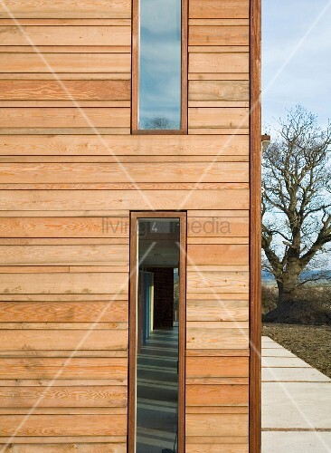 Narrow House Facade House With Narrow Vertical Windows In Wooden Facade Living4media