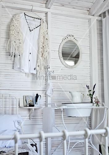 vintage waschsch ssel mit krug im metallgestell und hemd auf kleiderb gel an weiss gestrichener. Black Bedroom Furniture Sets. Home Design Ideas