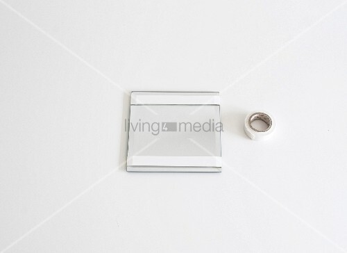 Mirror with areas masked with white masking tape