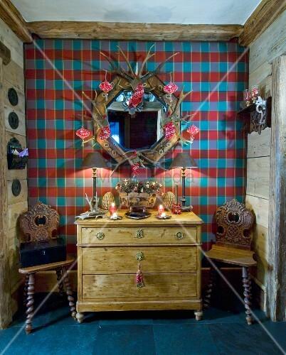 alte kommode und holzst hle vor karierter wand im chalet. Black Bedroom Furniture Sets. Home Design Ideas