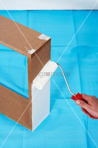 wandkonsole selber bauen holzrahmen weiss anstreichen bild kaufen living4media. Black Bedroom Furniture Sets. Home Design Ideas