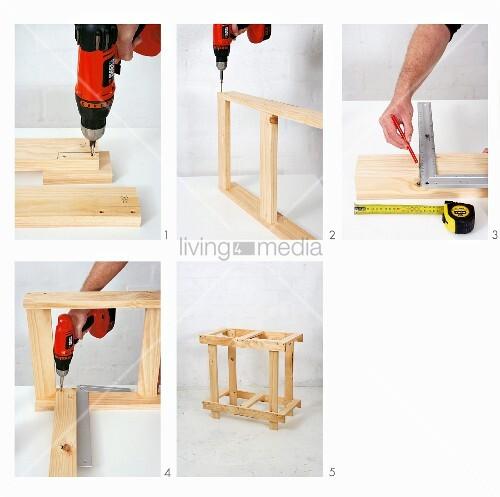 klappbaren holztisch selber bauen holzbretter vorbohren bild kaufen living4media. Black Bedroom Furniture Sets. Home Design Ideas
