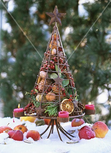 iron tree filled with fir cones candles fruit berries bild kaufen living4media. Black Bedroom Furniture Sets. Home Design Ideas