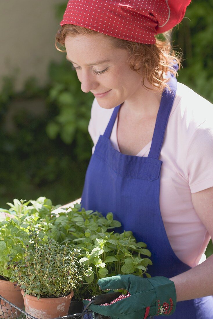 Young woman carrying fresh herbs