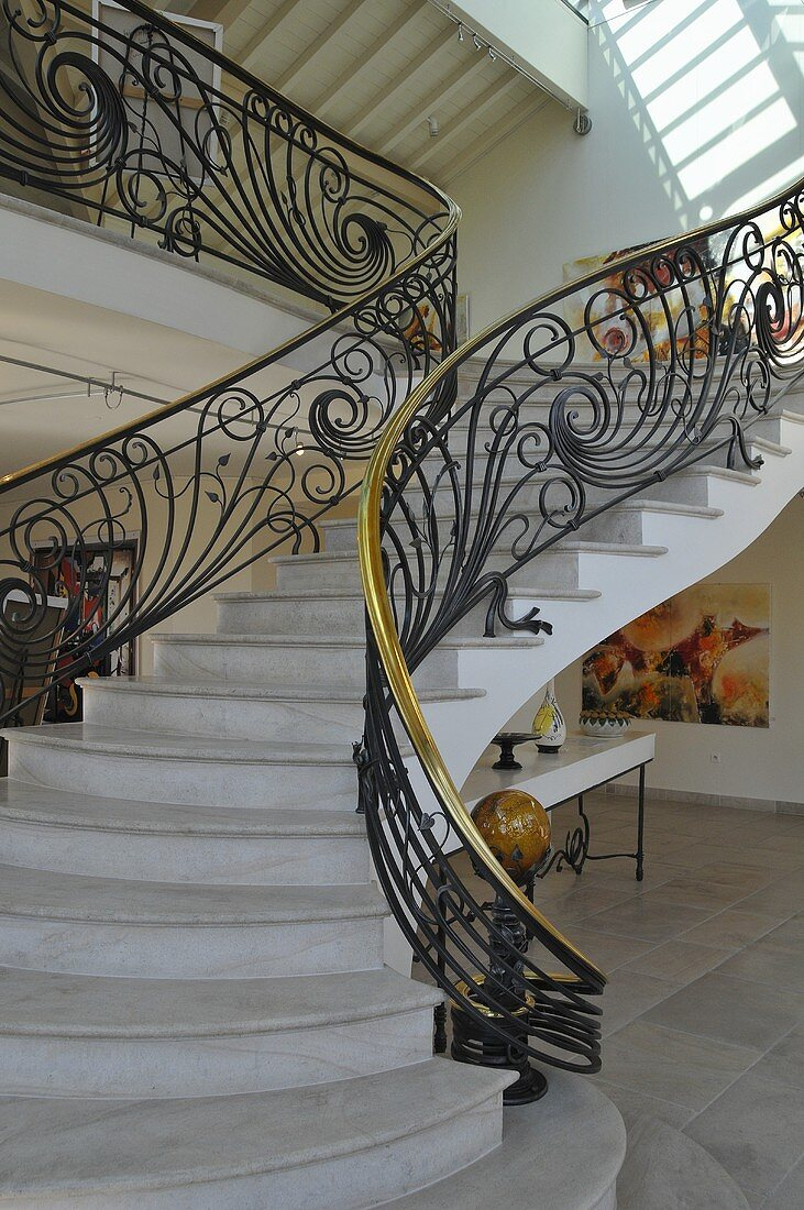 A flight of stairs with a banister rail
