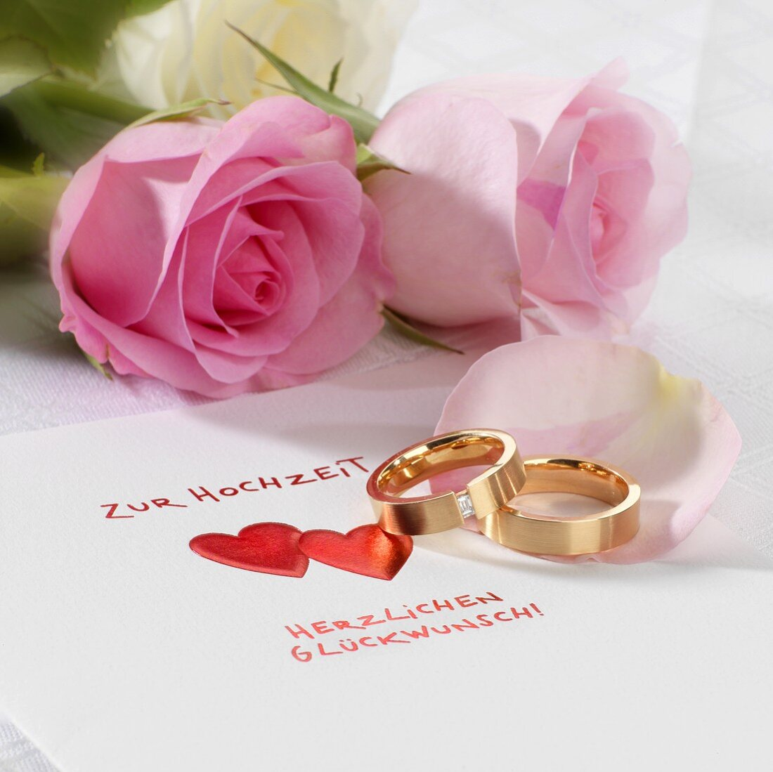 Wedding card, wedding rings and roses