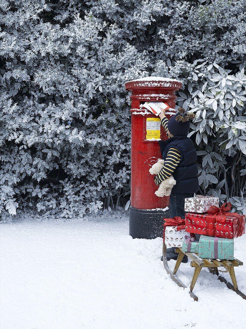 Child posting Christmas cards (UK)