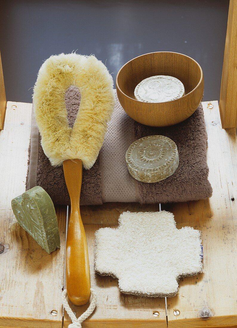 Bath brush, soaps and towel