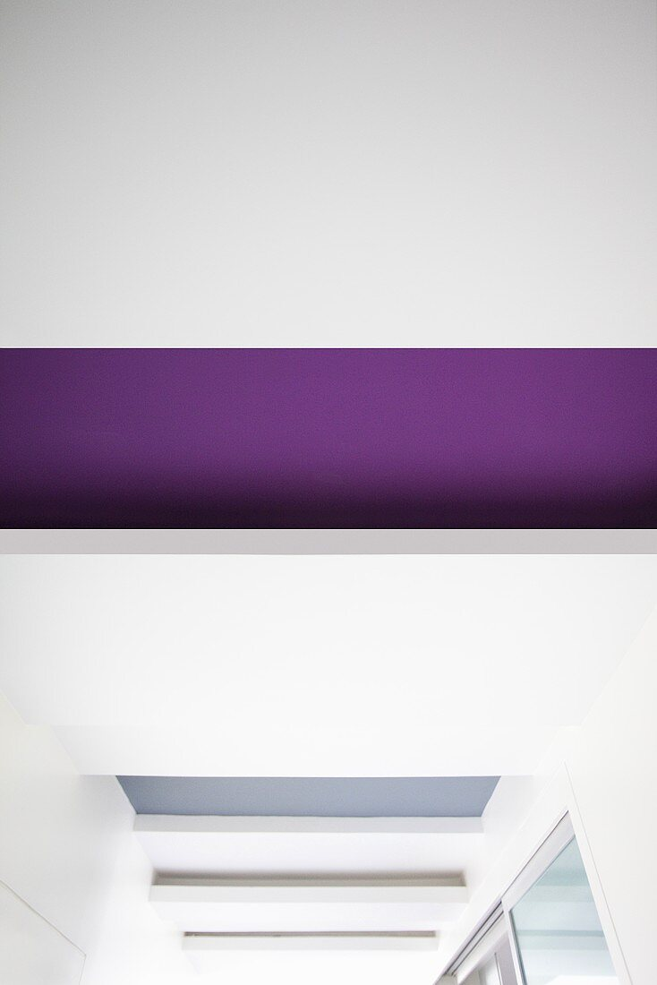 A painted area of ceiling interrupted by hanging ceiling partitions