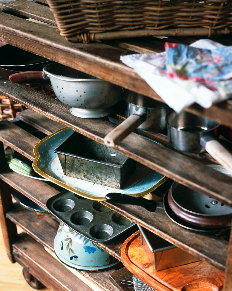Old baking tins and pots on a wooden shelf