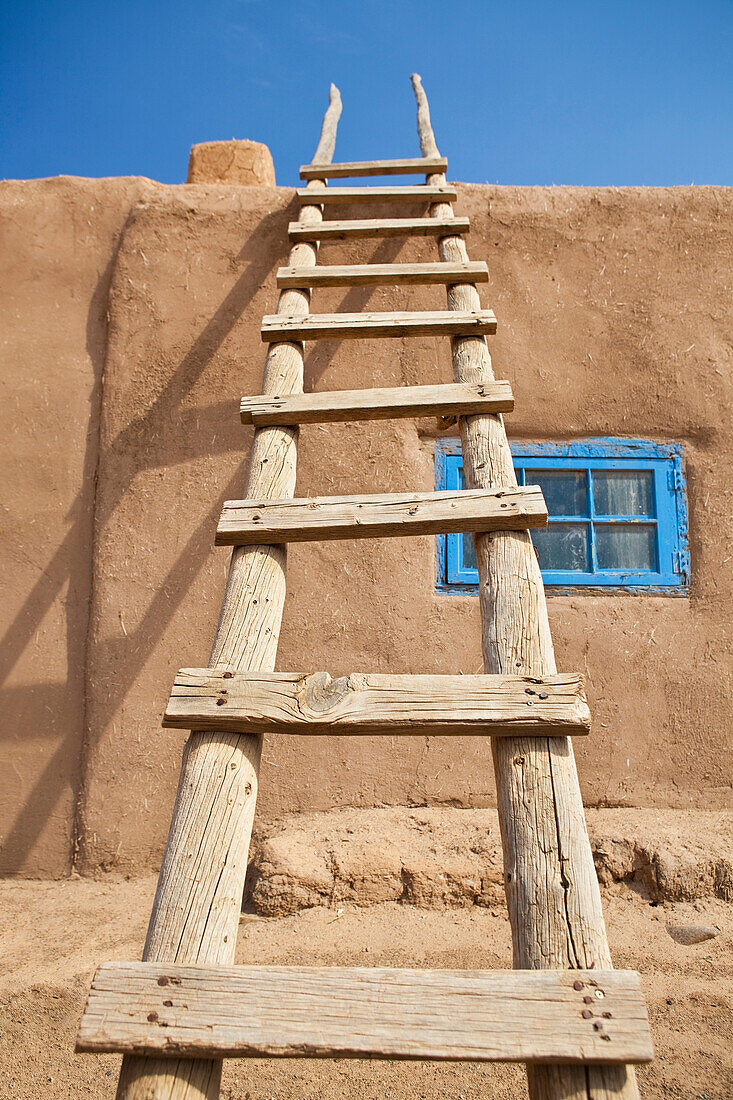 Wooden Ladder Against an Adobe Building, Taos, New Mexico, USA