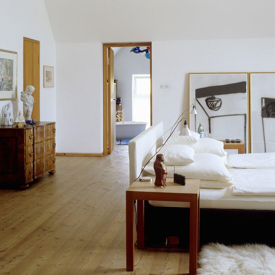 An attic bedroom with an en suite bathroom
