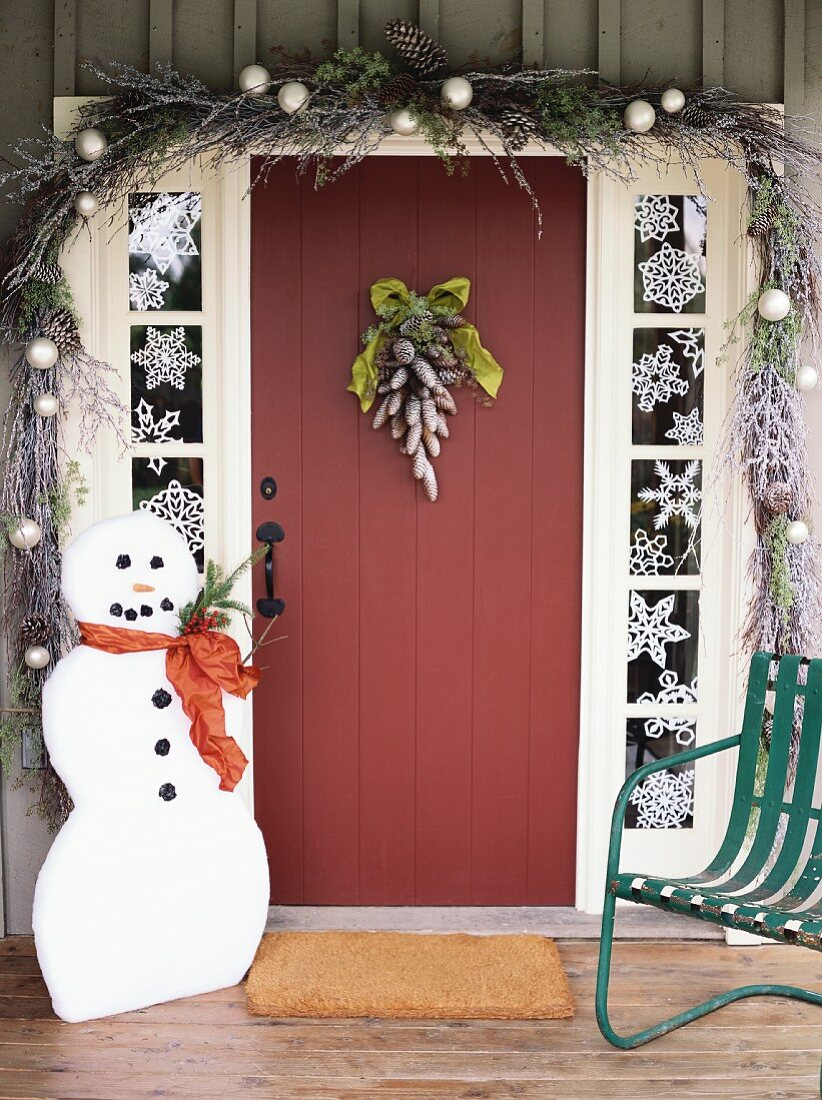 House door decorated for Christmas with snowman