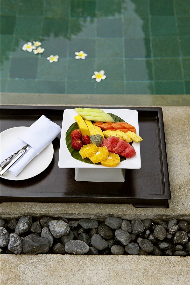 Plate of mixed fruit in Asian style