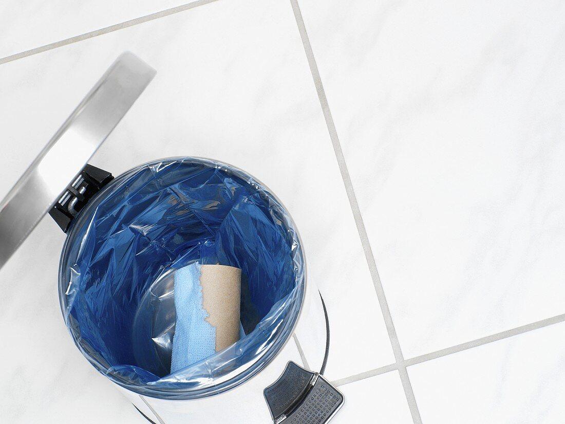 An empty toilet roll in a bin