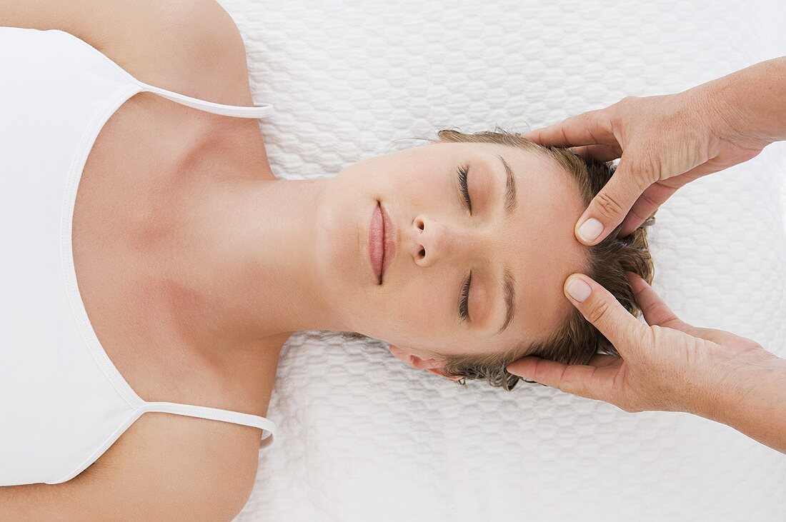 A woman having a head massage