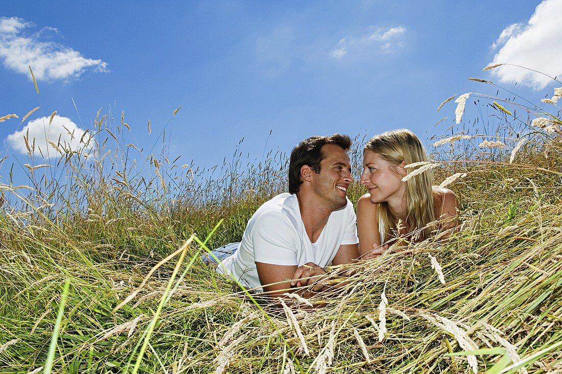A couple lying in a field