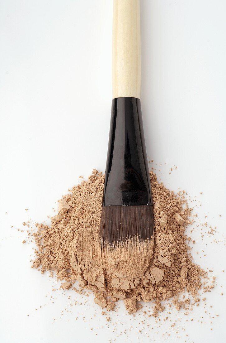 Beige powder with brush